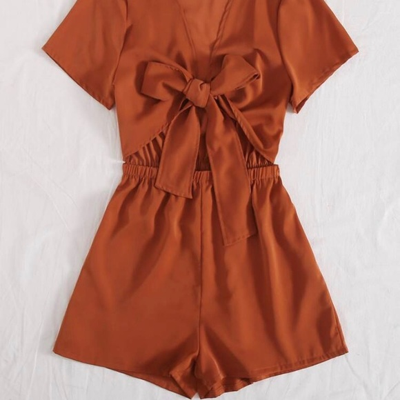 *NEVER WORN* Romper with Front Cut-Out